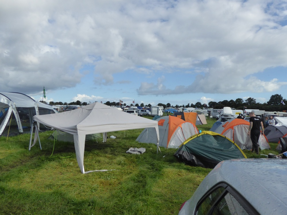 Wacken Open Air Campsite Aftermath, broken tents, gazebos, queuing cars