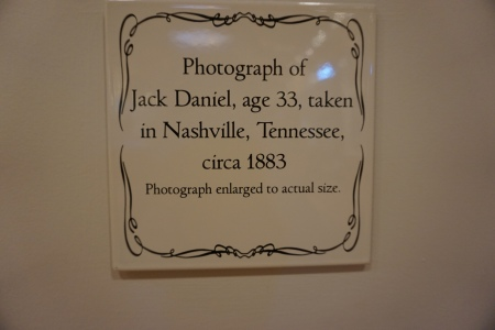 Sign next to photo of Jack Daniel in the Distillery, Lynchburg TN