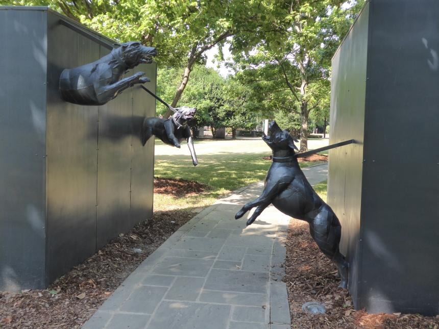 monument showing police dogs attacking in Kelly Ingram Park, Birmingham Alabama
